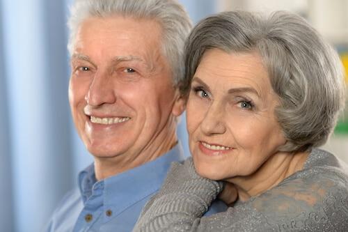 comparing dentures vs implants